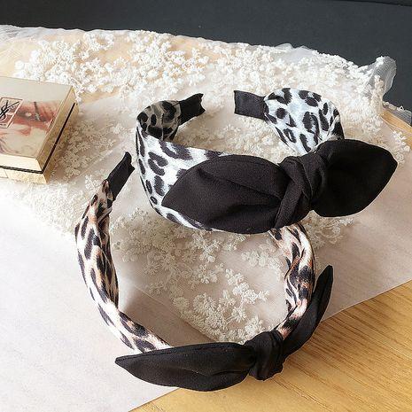 Korean leopard print color matching rabbit ears simple versatile headband  NHHI252917's discount tags