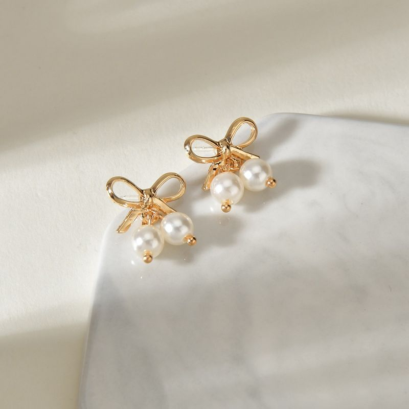 Bow pearl earrings female compact personality temperament earrings NHBQ253523