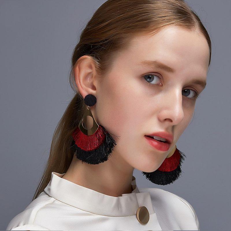 exaggerated hollow tassel earrings bohemian double fan-shaped retro earrings wholesale NHDP253090
