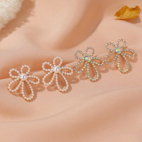 S925 Silver Needle  Pearl Flower Simple  Sweet Gradient Hollow Flower Stud Earrings  NHDP253128's discount tags
