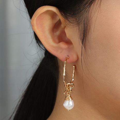 C-shaped bamboo metal  knotted hand-wound pearl advanced elegant earrings wholesale NHAN254190's discount tags