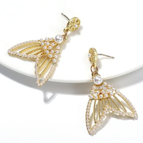 The new pure white pearl inlaid fishtail fashion girl creative earrings wholesale NHJQ254383's discount tags