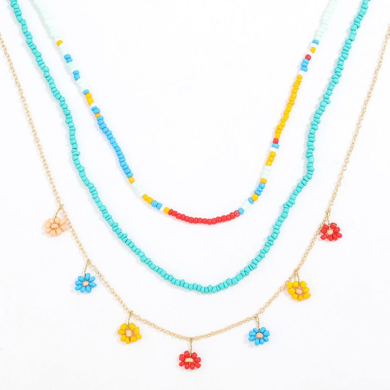 Fashion color rice bead multi-layer flower pendant hip hop necklace three-piece  NHJE254413