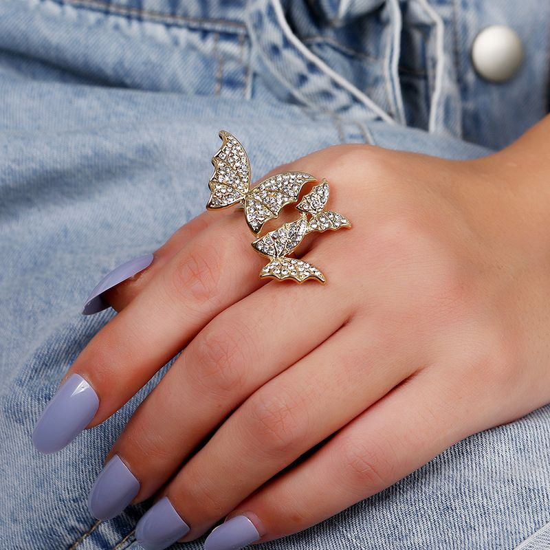 Simple   fashion diamond creative  flying butterfly ring NHKQ254494