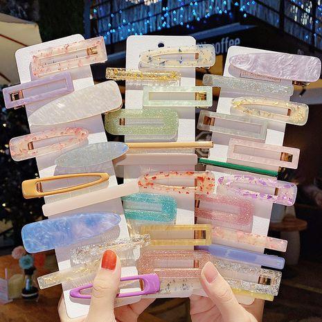 Épingle à cheveux acrylique coréenne 3 pièces ensemble clip latéral frange clip fille clip en gros NHNA254643's discount tags