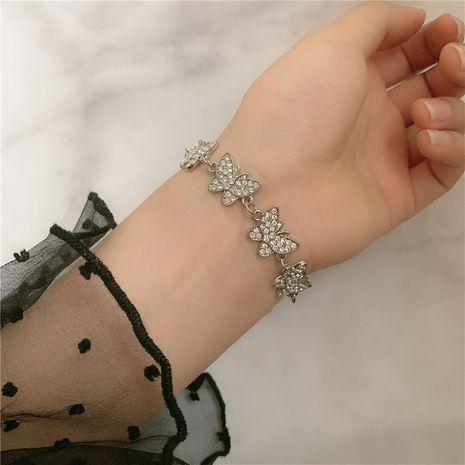 Bracelet en acier inoxydable micro-incrusté de papillon en strass NHYQ254763's discount tags