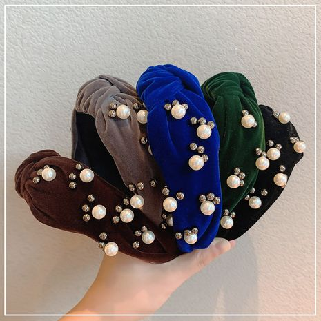 Korea's pearl women's retro velvet bow headband wholesale NHOF255395's discount tags