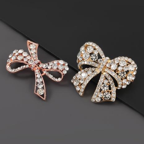 Broche à nœud super clignotant en alliage de mode sertie de diamants NHJE306020's discount tags
