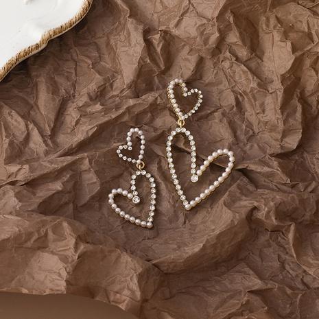 Korean love rhinestone pearl earrings  NHMS306704's discount tags