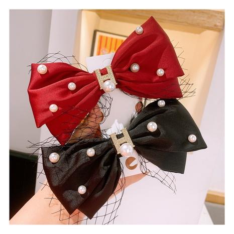 Korea simple bow knot polka dot retro red ear pearl hairband NHHD306814's discount tags