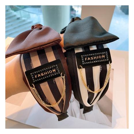 Korea Retro Striped Letter Rhinestone Tassel Hair Band NHHD306817's discount tags