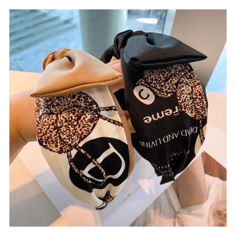 Korean new retro silk letter bow headband NHHD306822's discount tags