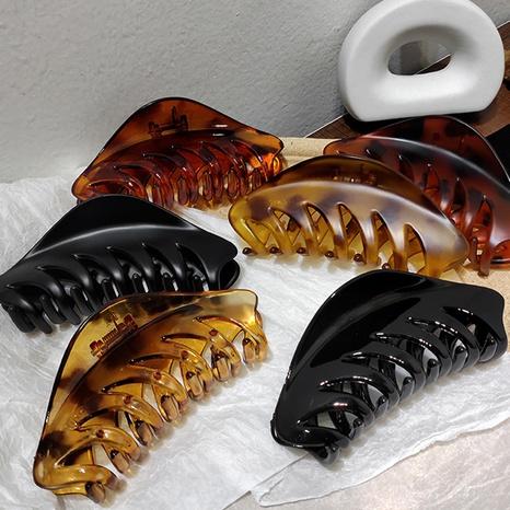 Simple korean leopard print hair clip NHAR306897's discount tags