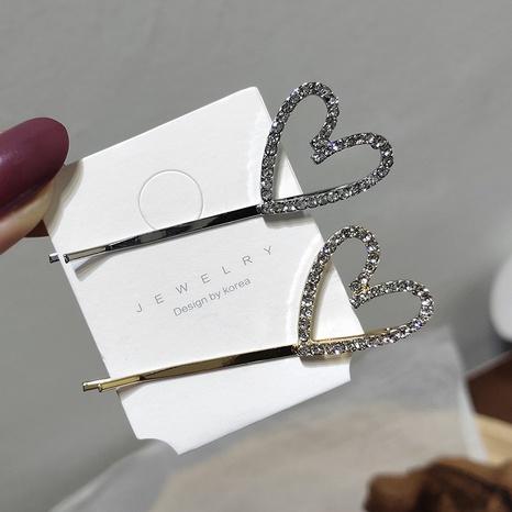 Koreanische einfache Diamant hohle Liebe Haarnadel NHAR306932's discount tags