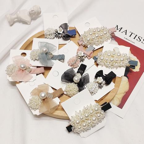 Korean simple pearl wild bow hair clip NHAR306933's discount tags