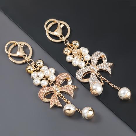 porte-clés de fleur de perle de bowknot de diamant d'alliage NHJE307372's discount tags