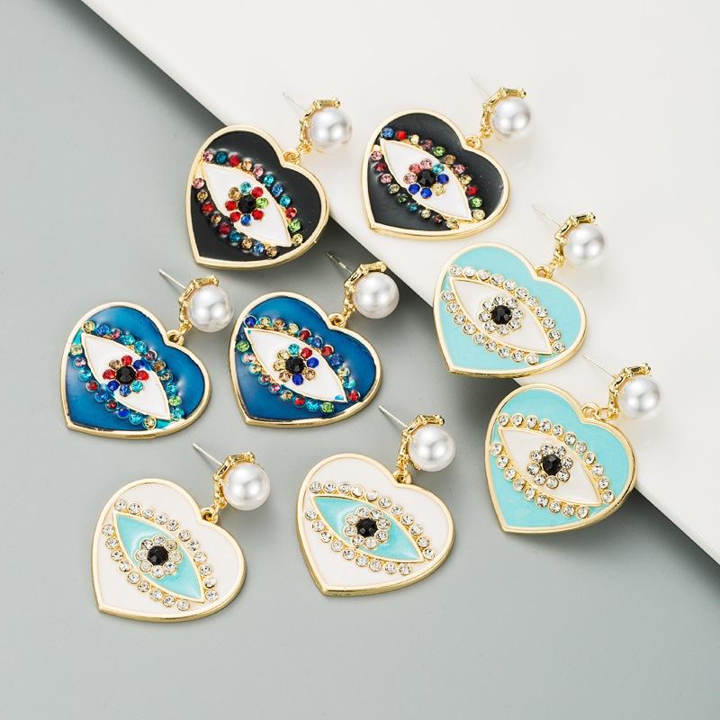 fashion heart-shaped demon eyes imitation pearl earrings NHLN307838