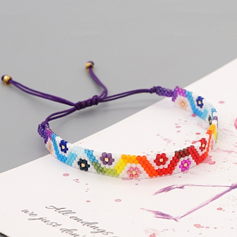 Fashion Rainbow Gradient Color Eyes Beaded Bracelet NHGW307940's discount tags