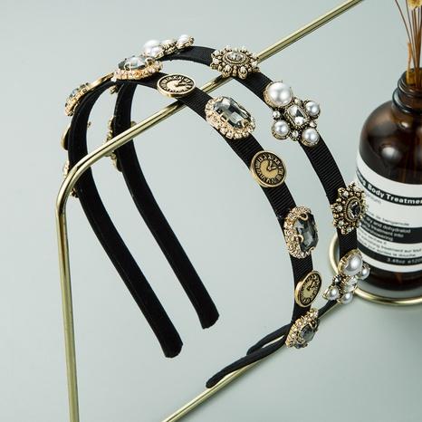 New simple fashion alloy pearl rhinestone headband NHLN309339's discount tags