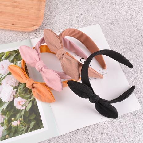 Korea new pure color simple fabric rabbit ears headband  NHAQ309889's discount tags
