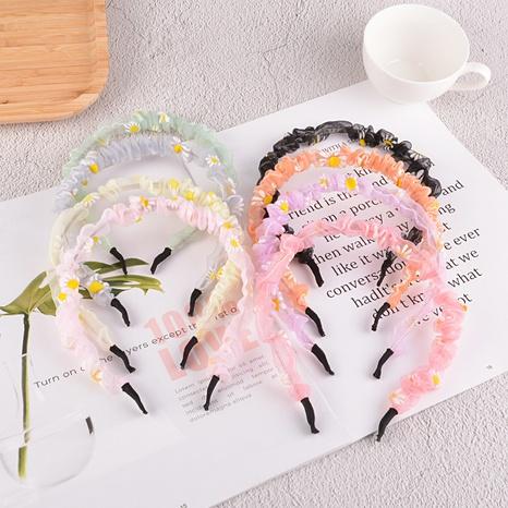 Korean new pure color daisy hair band  NHAQ309900's discount tags