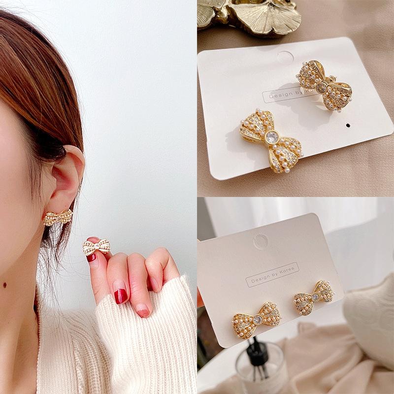 diamond-studded alloy bow earrings NHHI310357