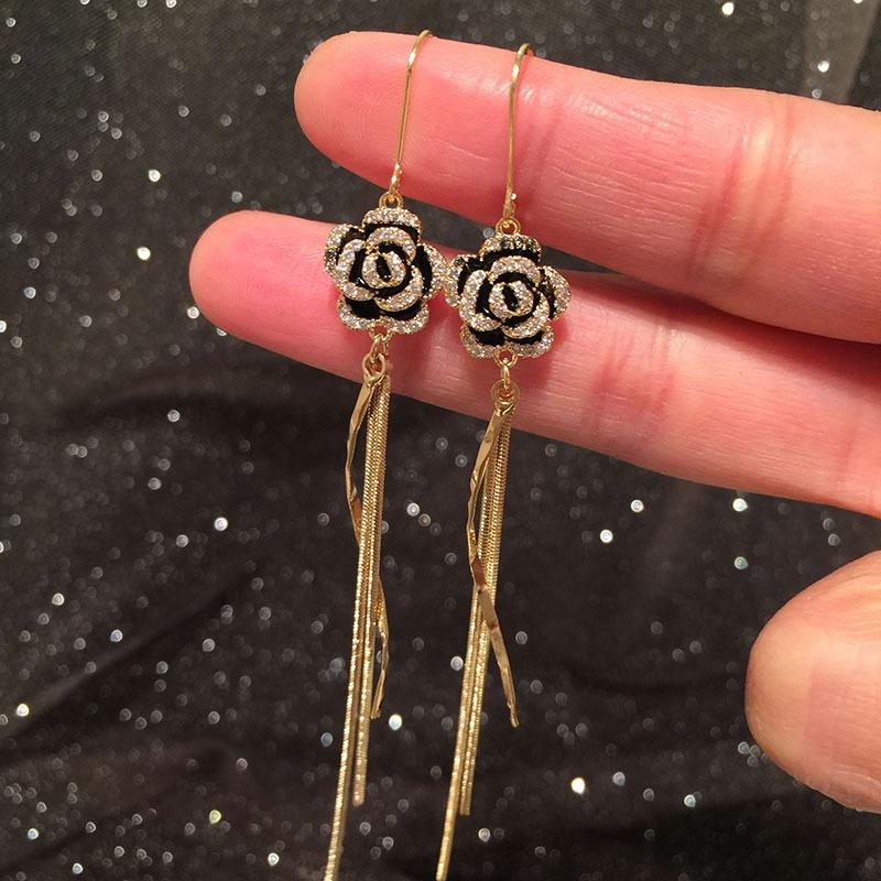 Golden rose long earrings NHWK311378