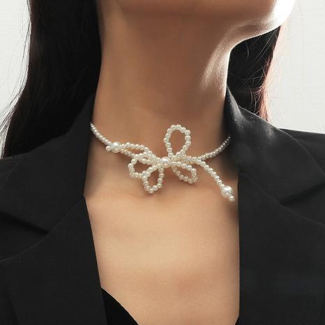 Collier nœud de perles coréen mignon NHLA312202's discount tags