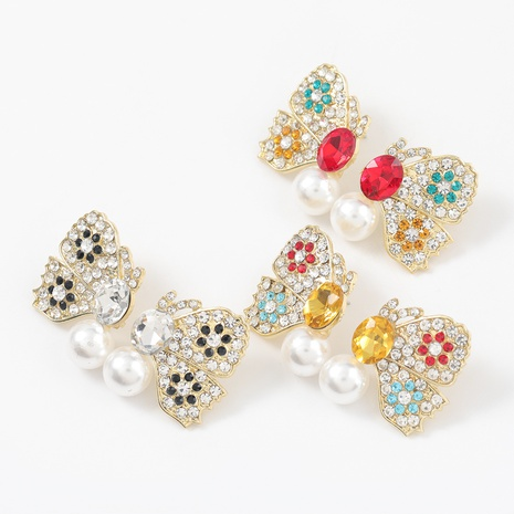Korean fashion alloy diamond inlaid pearl butterfly earrings  NHJE312278's discount tags