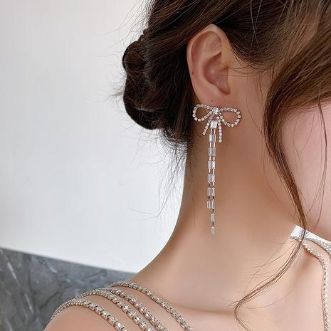 Rhinestone zircon bow long tassel earrings  NHMS312385's discount tags