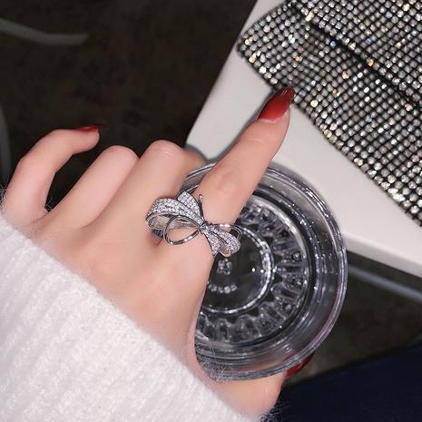 Mode mikro-eingelegter Zirkonbogen offener Ring NHMS312403's discount tags