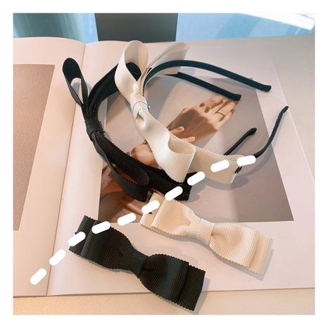 diadema con lazo de moda en blanco y negro NHHD312546's discount tags