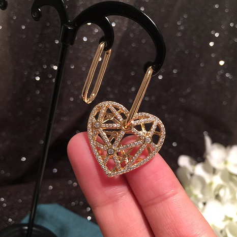 asymmetric creative hollow heart earrings NHWK312702's discount tags