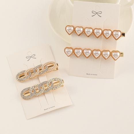 Korea cute heart-shaped diamond-studded pearl hairpin NHAU312708's discount tags