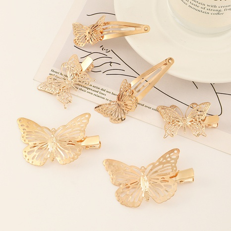 simple alloy iron gold hollow butterfly hairpin set NHAU312710's discount tags