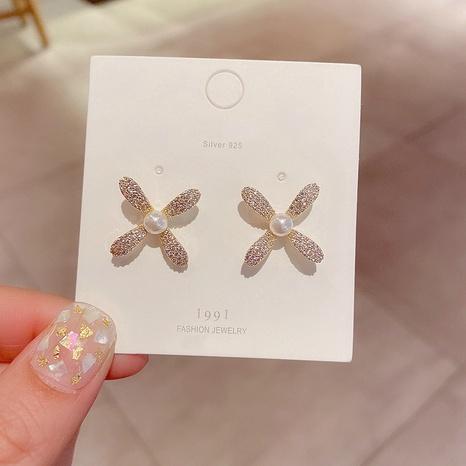 Koreanische einfache Zirkon Micro eingelegte Perle Blumenohrringe NHCG313088's discount tags