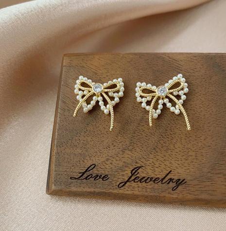Bowknot imitation pearl fashion sense earrings NHOT303646's discount tags