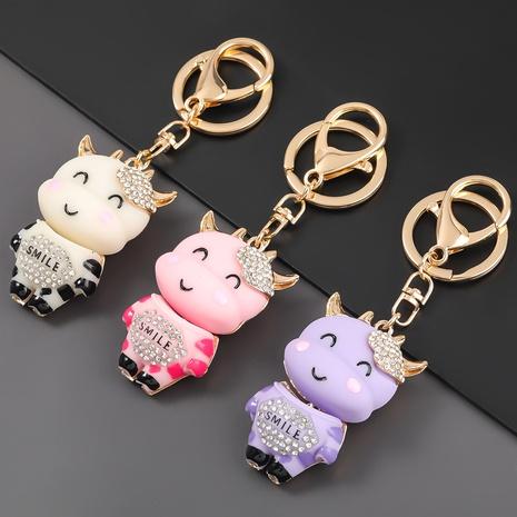 porte-clés en alliage de résine diamant sourire veau NHJE303124's discount tags