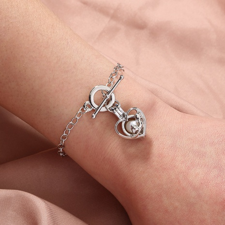 pearl peach heart cage bracelet  NHAN303679's discount tags