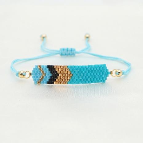 handgewebtes ethnisches blaues Pfeil geometrisches Perlenarmband NHGW303691's discount tags