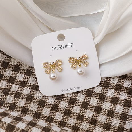 Sweet pearl bow earrings  NHMS303742's discount tags