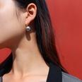 NHOK1378568-Pair-of-golden-grey-pearl-earrings