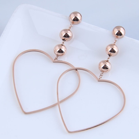Korean fashion simple peach heart titanium steel exaggerated earrings NHSC304811's discount tags