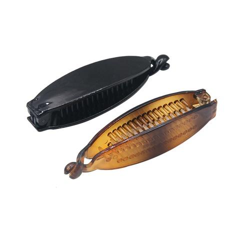 Korean black oval plastic PC banana clip NHBE304706's discount tags