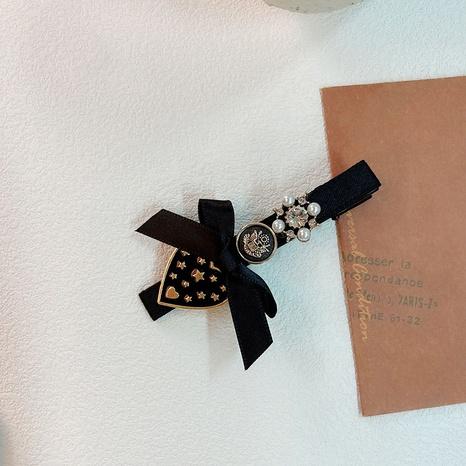 Korean retro velvet cloth bow hairpin NHWF304842's discount tags