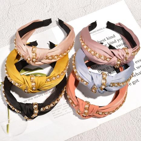 Korean fashion pearl chain knotted hair band NHAQ304999's discount tags