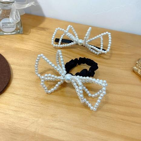 Pince à ressort en épingle à cheveux coréenne arc perle pince à cheveux cassée NHWF305650's discount tags
