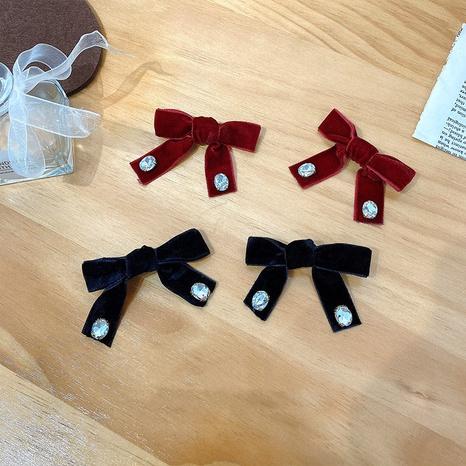 Accessoires pour cheveux en épingle à cheveux avec pince à bec de canard arc coréen NHWF305648's discount tags