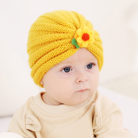 2021 autumn and winter children's woolen knitted hats cute little flowers warm caps  NHWO442991's discount tags