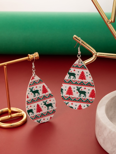 European and American Fashion Fun Christmas Tree PU Leather Earrings NHGY444859's discount tags